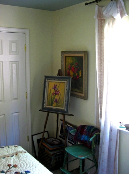 'Plain vanilla' guest room serves as background for an embroidered bedspread and my Grandma's already colorful paintings